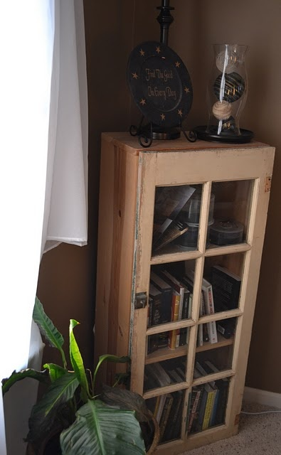 Fran - what do you think?  old window turned bookshelf   You could even turn it on its side and the glass be the top.    like it...