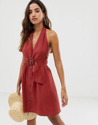 02929c918df ASOS DESIGN halter neck mini button through linen sundress with buckle Asos  Dress