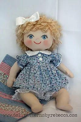 """RC602E  Maggie Mae 18 Baby Doll Sewing Pattern  PDF Maggie Mae is a cuddly 18"""" baby doll.   Safe for any age and easy to make.   Soft textured yarn give the appearance of baby hair.  She comes complete with a simple dolls strip quilt which is included in the pattern.   Her face can be embroidered or painted, powdered makeup blush for her cheeks.  Original Design by Rebecca McGovern"""