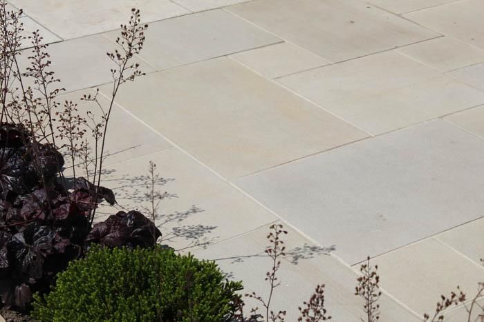 Multi Buff Sawn Sandstone has a sawn and shotblasted surface and contains a beautiful, mellow blend of pink, peach, yellow and cream tones.