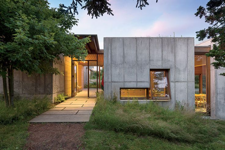 Martha's Vineyard prefab with a thick concrete facade has large dramatic openings