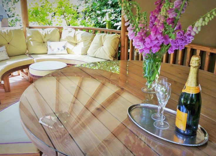 What better way to enjoy champagne than in your very own Breeze House. Featuring separate lounge and dining areas our Oval Savannah Breeze House is the perfect garden retreat. #garden #gardening #outdoorideas #outdoorinspo #gardeninspo #BreezeHouse #gazebo #champagne #flowers