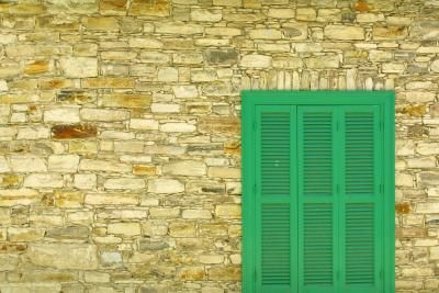 The right shutter color adds visual interest to a stone house.