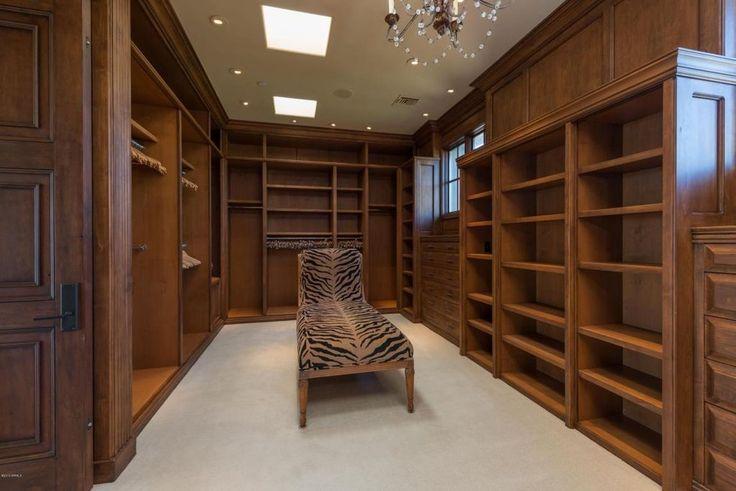 Craftsman Closet with Carpet, High ceiling, Skylight, Pendant Light, Luxury Wood Custom Closets, Built-in bookshelf
