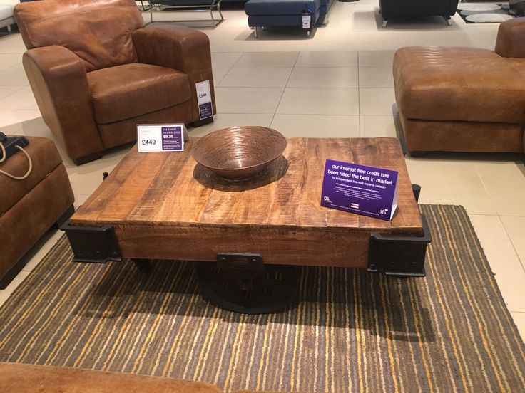 Coffee Table in the shape of a Train flat wagon truck,Solid wood & metal wheels saw in the DFS furniture store