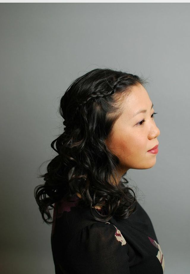 Side profile of pin straight hair done up in curls.