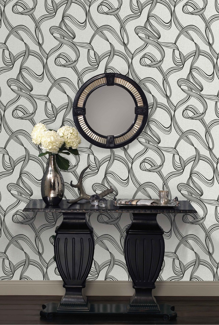 Ribbon - A modern free flowing ribbon trail, created with a suede ink, on a subtle animal print metallic textural ground.