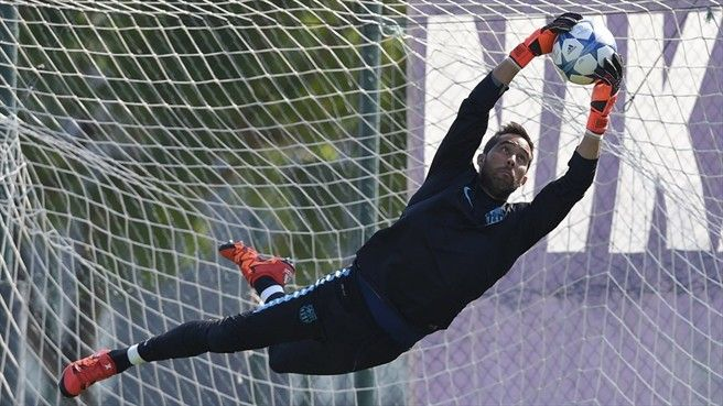 Goalkeeper Claudio Bravo of Barcelona takes part in a training session ahead of their UEFA Champions League group stage match against Leverkusen
