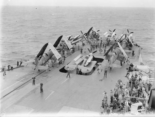 HMS ILLUSTRIOUS stows her Barracudas and Corsairs after a raid on the Andaman Islands.