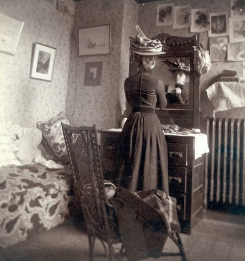 Woman at Mirror, ca 1900  ~ don't you just love old pictures, notice the chair, wall hangings, woodwork how simple yet dignified they lived.