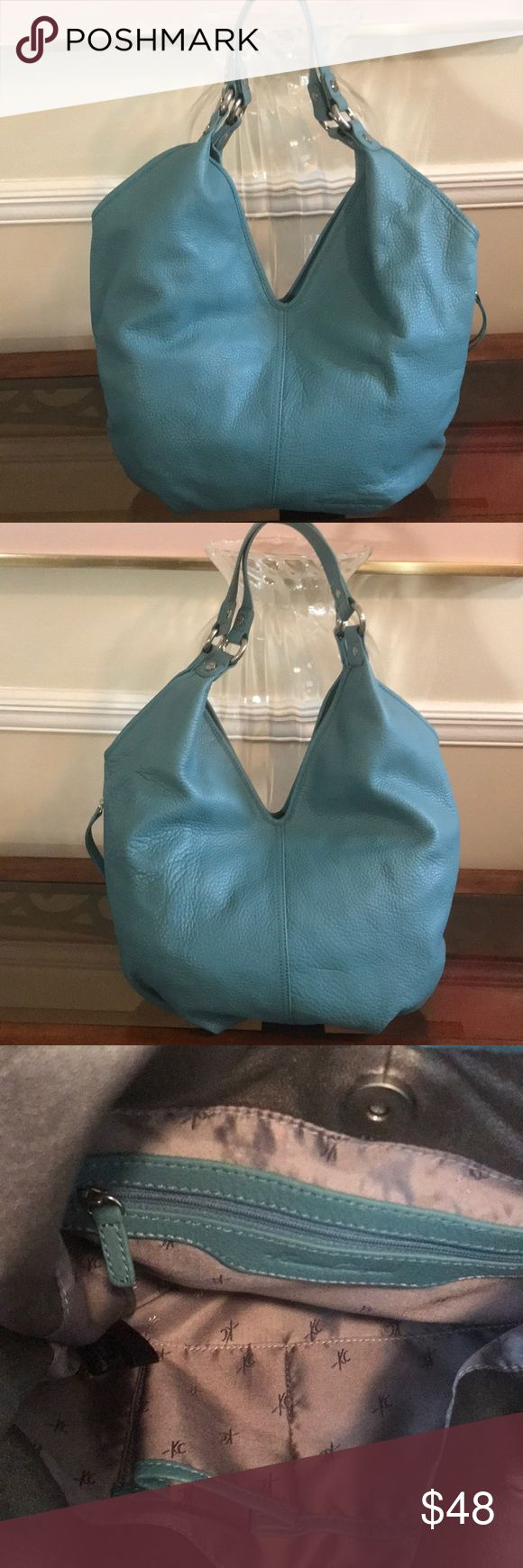 """🔴KENNETH COAL HANDBAG 🔴BEAUTIFUL KENNETH COLE PEBBLED LEATHER IN MUTED TURQUOISE. HARDWARE HAS IS IN A BRUSHED SILVER TONE. ONE SIDE EXTERIOR POCKET. ONE INTERIOR POCKET WITH A CELL PHONE AND ONE   COMPARTMENT FOR FEW ESSENTIALS INTERIOR IS CLEAN. IT HAS ONE TINY INTERIOR NICK. 🔴PLEASE LOOK AT LAST PHOTO.  WIDEST PART OF BAG IS APPROXIMATELY 17"""". APPROXIMATELY 12""""L HANDLES DROP APPROXIMATELY 12"""" TO THE """"""""V"""" SHAPE OF BAG. BEAUTIFUL BAG FOR A SUBTLE POP OF COLOR. Kenneth Cole Bags"""