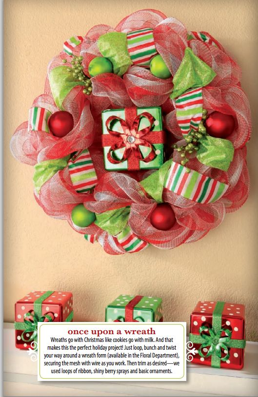 For a festive DIY Christmas wreath, decorate a wreath form with deco mesh ribbon, ornaments, and berry sprays.