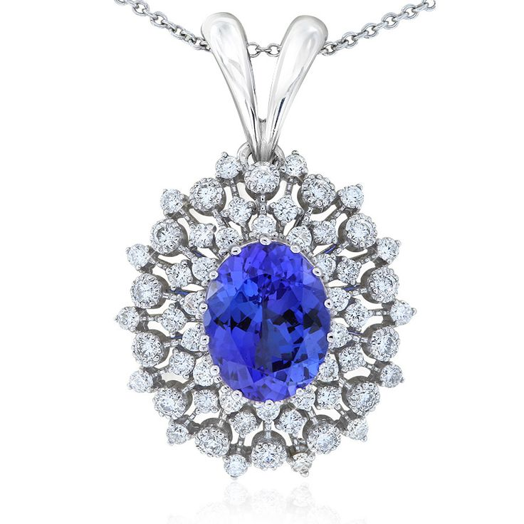 Rare and beautiful. Kilimanjaro tanzanite and diamond in an intricate cluster style pendant. This oval tanzanite is a deep purple-blue colour. Crafted in 18ct white gold. The 18ct gold chain is adjustable from 42 - 45cm long.
