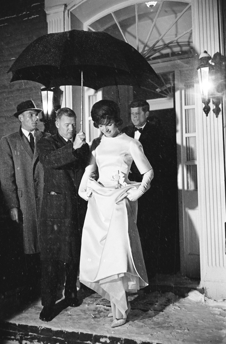 Jan. 19, 1961: Jackie Kennedy stepping out into the snowfall en route to Pre-Inaugural Gala with JFK behind her.