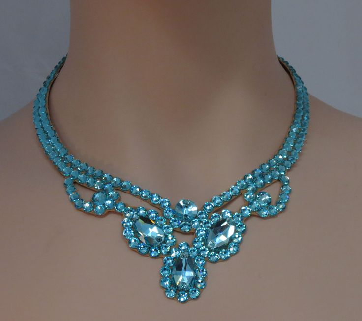 Swarovski crystal design in Light Turquoise There are three pear stones that create an interesting shape in the front of the necklace. It tapers in the back for comfort and attaches with velcro so the