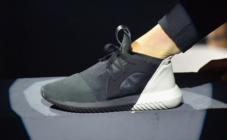 Adidas Tubular Doom sneaker range for SS16. Grey tone on tone. nCool use of Free-running and spotlights to create a catwalk show above and around the audience.