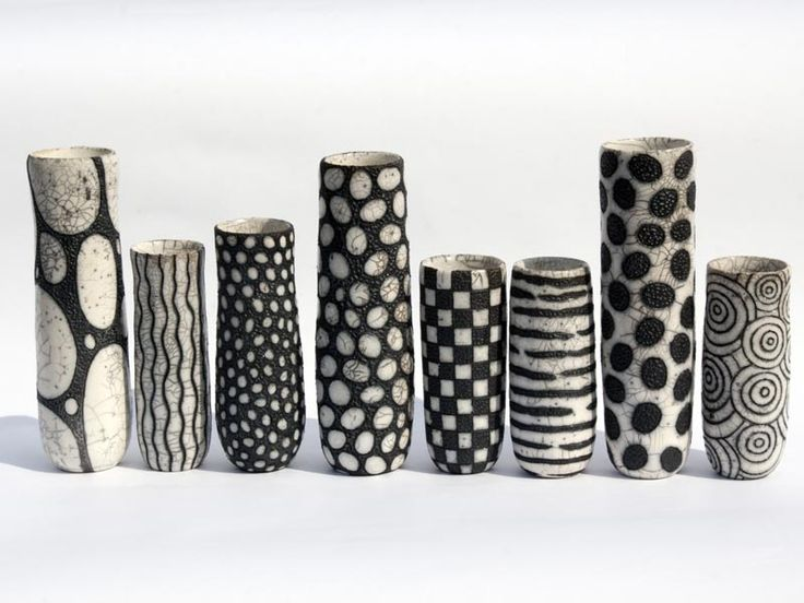 http://camillecampignion.com/site/images/photos/4144.jpg This collection of vases is just beautiful. The crackle finish is incredible. I'd love to have any of them.