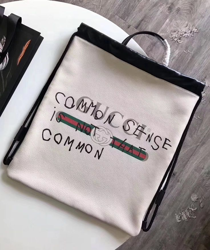 a7f95b6acd33 The leather of the Gucci Coco Capitan logo White backpack is soft, elegant  and feels great. We liked the motto on the backpack itself, which is