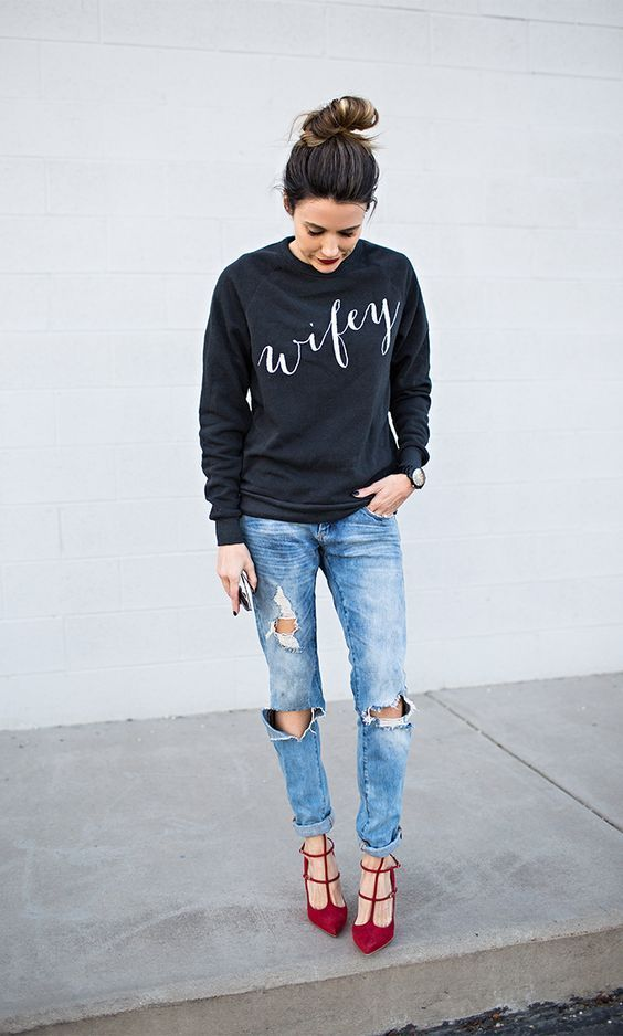 Opt for a black and white print crew-neck jumper and light blue distressed boyfriend jeans for a casual get-up. Red suede pumps will add a touch of polish to an otherwise low-key look.   Shop this look on Lookastic: https://lookastic.com/women/looks/black-and-white-crew-neck-sweater-light-blue-boyfriend-jeans-red-pumps/16144   — Black and White Print Crew-neck Sweater  — Black Ceramic Watch  — Light Blue Ripped Boyfriend Jeans  — Red Suede Pumps
