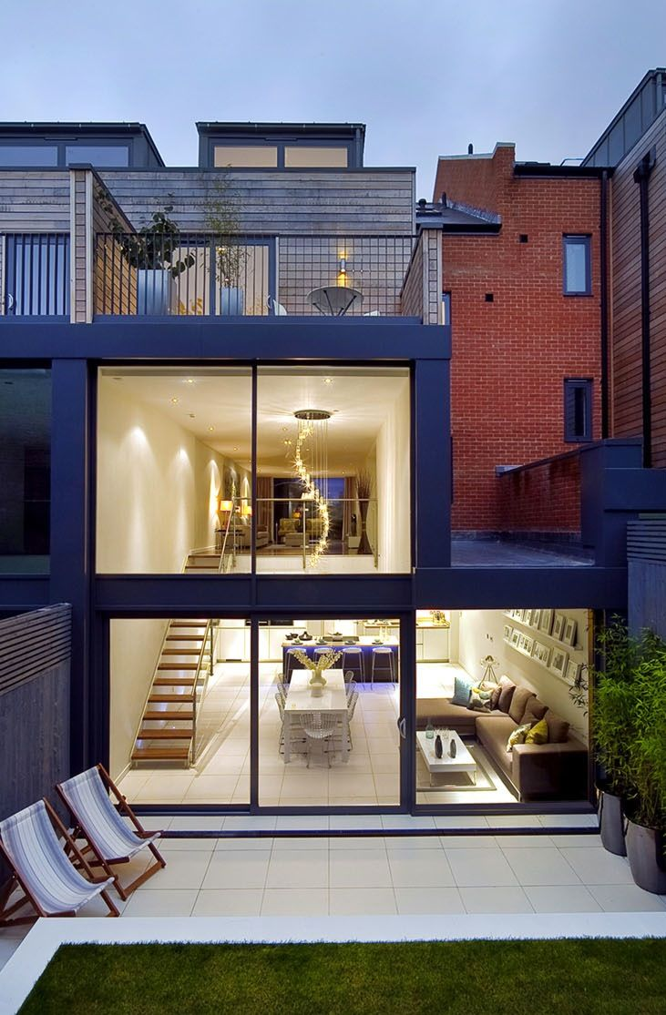 rear external night Exquisite House in London With Double Volume Space by LLI Design