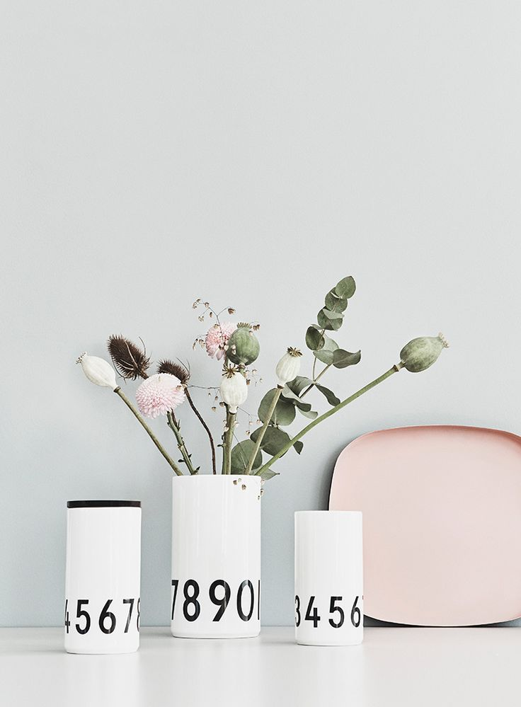 Beautiful simple porcelain vases. Danish Design. Typography: AJ Vintage ABC. Looks good with or without plants. Add a lid and turn the vase into a storage jar.