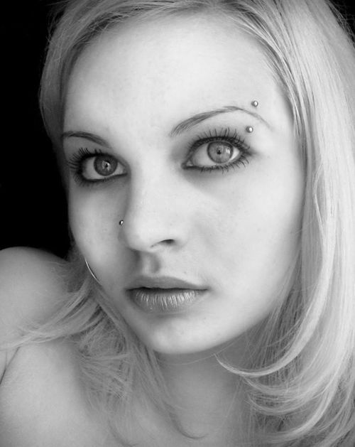 The exact facial piercing look I'd want. Simple eyebrow and opposite side nose piercing. It strikes me as badass, but classy.