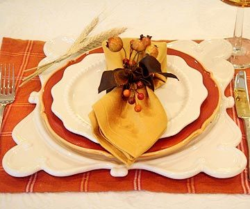 Fall Table Setting Ideas- -A silk ribbon and artificial berries turn this simple napkin fold into something special for your holiday dinner table