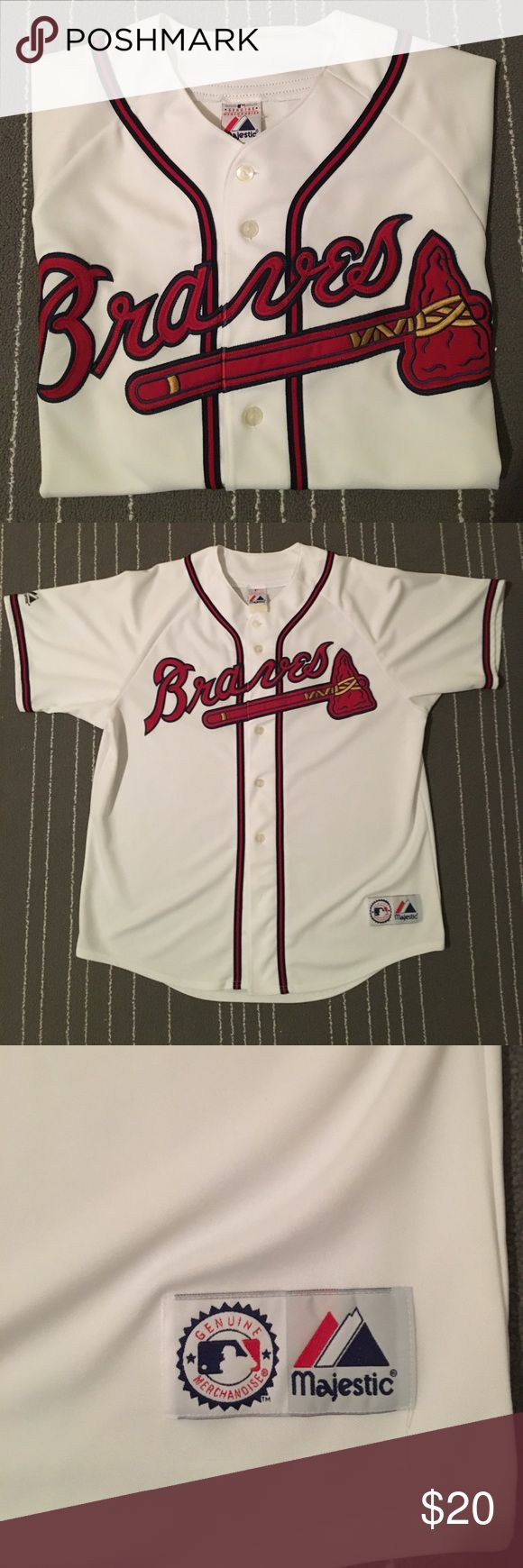 Majestic Genuine Atlanta Braves Men's Jersey MLB Genuine Merchandise by Majestic Atlanta Braves Men's Jersey. The size has worn off the tag but it fits like an XL. The bottom bottom is missing (see pic) but other than that no visible stains/defects that I see. Majestic Shirts