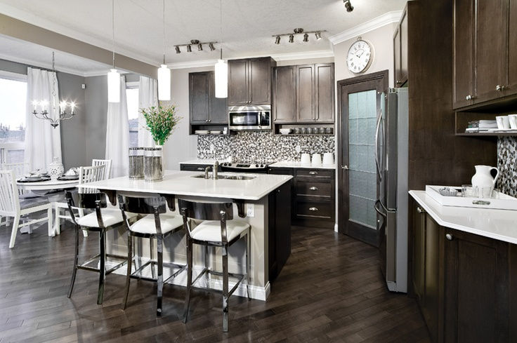 Kitchen and dining nook in Tofino Showhome in Cougar Ridge in southwest Calgary, Alberta, by Shane Homes