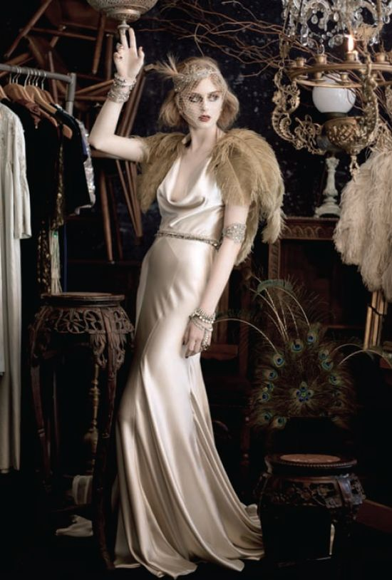 Beautiful in ivory, the 1920s style reflects a much more sophisticated wedding influence. #vintage #brides