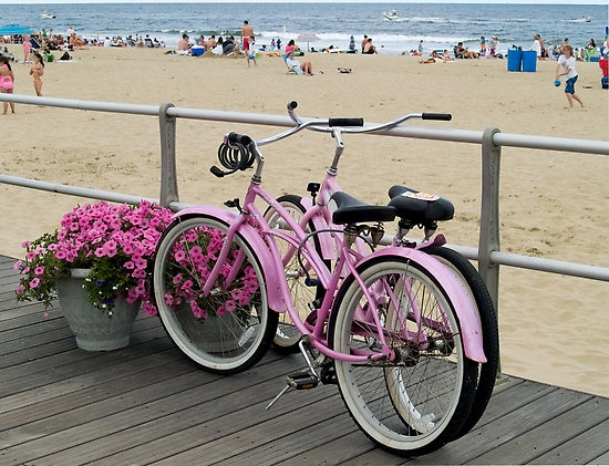 A shot of two pink bicycles on the boardwalk at Avon by the Sea, along the New Jersey shore.