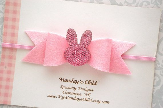 A sweet little bunny bow for her Easter basket! Soft pink wool blend felt has been used to make the 4 inch bow. It has a pink acrylic bunny center