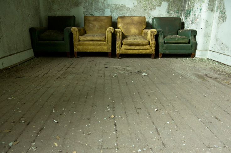 Four lounge chairs in the 1872 Maples Building at Willard State Hospital - formerly the New York State Asylum for the Chronic Insane.