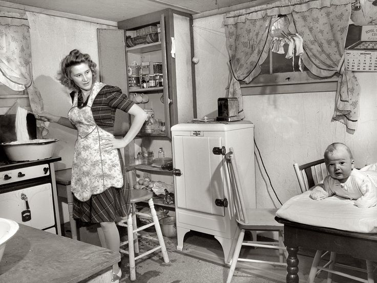 Boiling diapers with baby on table in 1943. We have come along ways as far as safety and all diaper types
