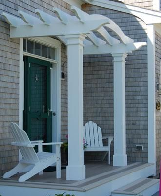 "Front Entry Pergola - Even a modestly-scaled front entrance porch is enhanced and dignified by a pergola. This arched structure with 8"" square columns features low maintenance cellular vinyl construction."