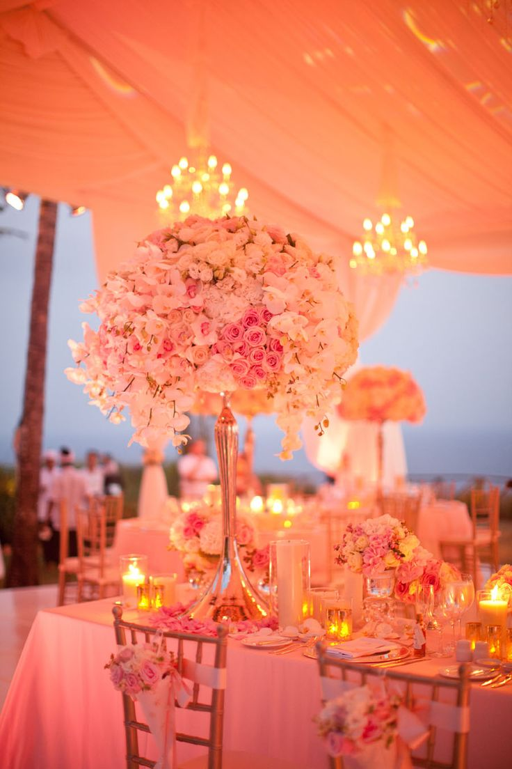 Pink wedding floral centerpiece. GLADYS & HENRY ARE MARRIED IN BALI | Samuel Lippke Studios