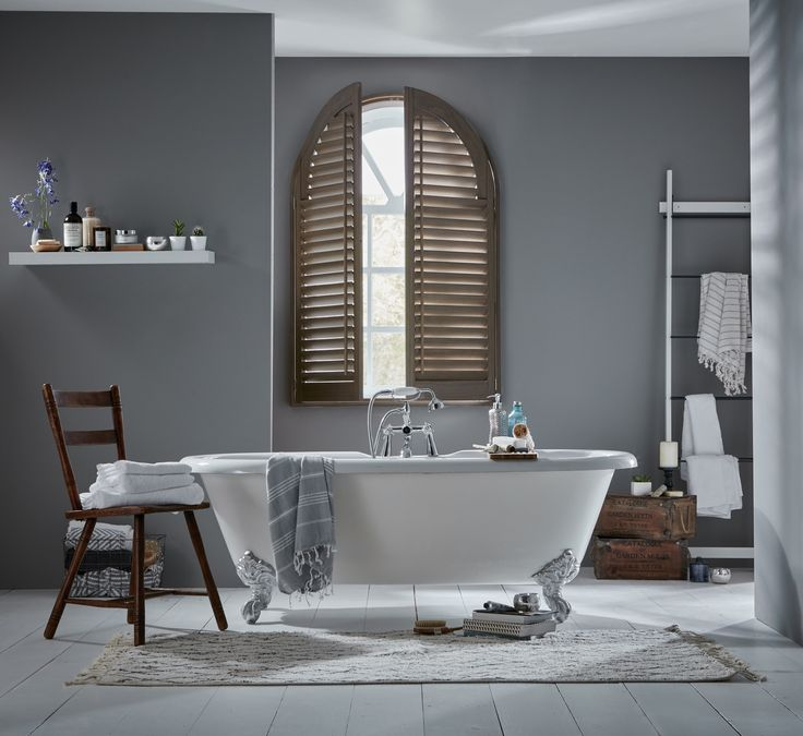 Arched bathroom shutters by Apollo. Bespoke shutters. Unusual shaped shutters home decor inspiration. Contemporary bathroom decor inspiration.