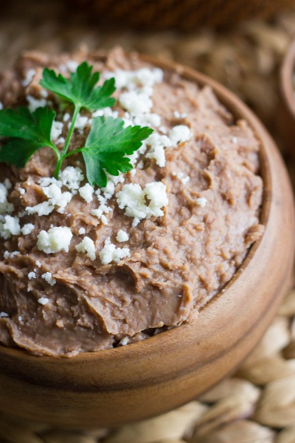 Healthy Crockpot Refried Beans - Packed with fiber and protein, and super easy to make.