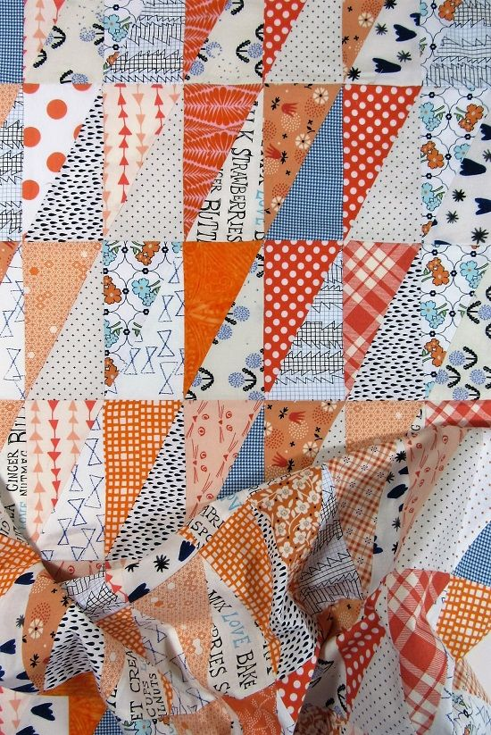 Auburn Low Volume Baby Quilt - Orange and Blue Half Rectangle Triangles.  These prints are adorable!