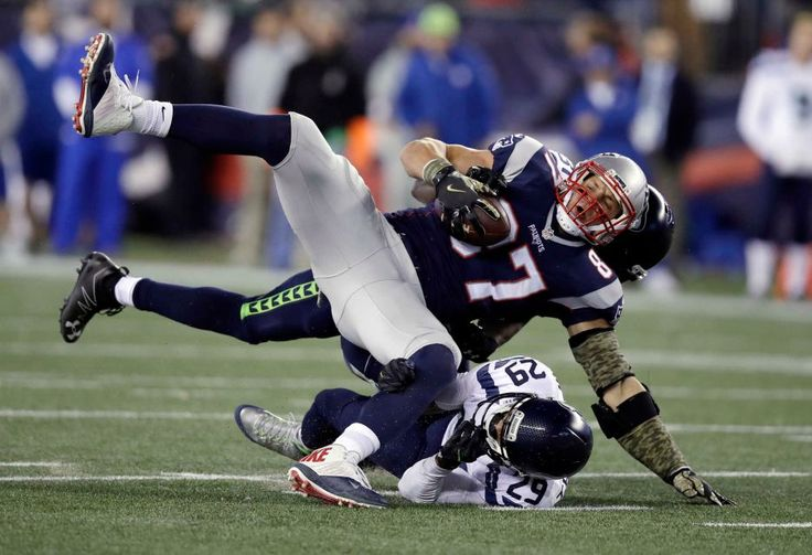 Seahawks vs. Patriots:  31-24, Seahawks  -  November 10, 2016  -   Seattle Seahawks safeties Earl Thomas and Kam Chancellor, rear, tackle New England Patriots tight end Rob Gronkowski during the first half of an NFL football game, Sunday, Nov. 13, 2016, in Foxborough, Mass.