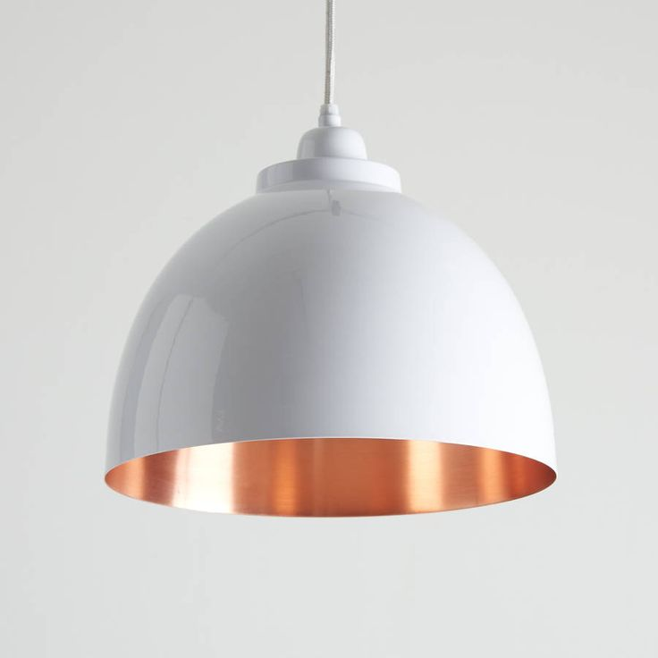 Lovely white and copper pendant light!This stunning, traditionally styled pendant is made from aluminium and then powder coated a glossy white, with a copper finish on the inside for a lovely warm glow. It looks great lit or unlit. It comes with approximately 100cm of white flex that can be shortened to any length and matching powder coated aluminium ceiling rose. Ideal in kitchens, dining rooms, hallways or living rooms, they look great on their own and also in twos or threes. Takes a…