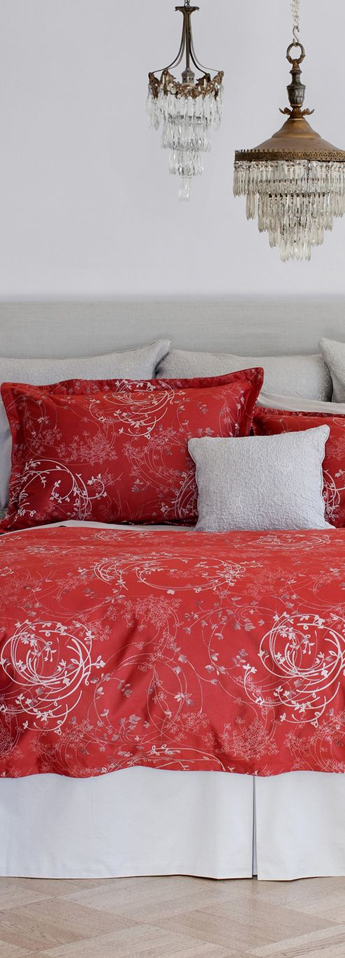 Arianna's berry red and icy grey palate epitomizes winter at its best. A rich ruby backdrop showcases delicate silver branches, bringing a contemporary edge to a classic design. #red #bed #bold #bedroom #duvet #cover #shams #contemporary #linens #home