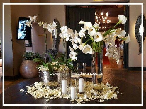 Entrance table at Lobola Kraal #loveflowers #orchids #arumlilies courtesy of Oopsie Daisy