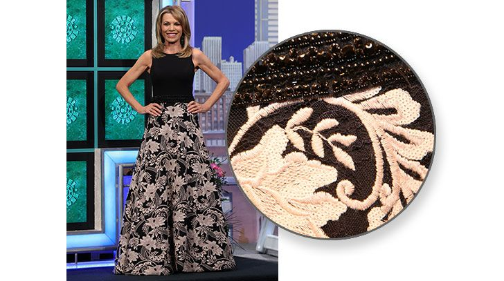 "JOVANI Ballgown w/black crepe bodice, scoop neckline, sleeveless, bed & sequin ""belt"" at waist, full skirt in black w/embroidered beige abstract floral pattern, train 