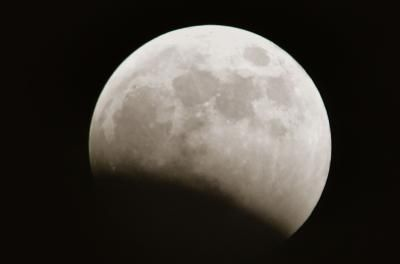 The moon in the beginning stages of a lunar eclipse