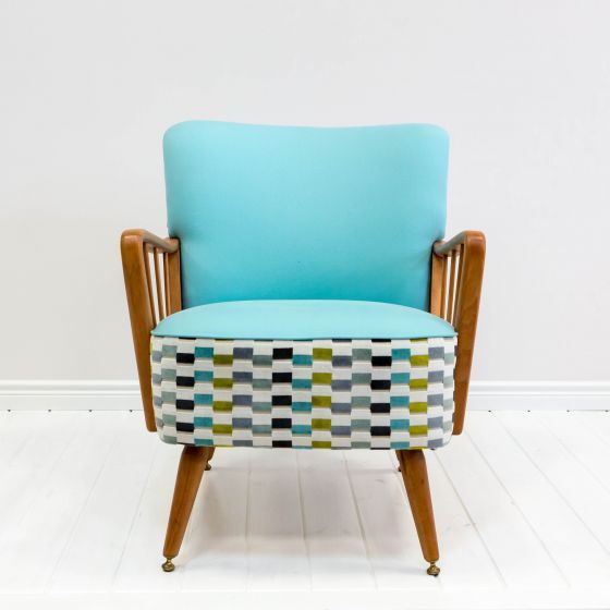 Mid-century modern armchair Craftology. Modern colours and patterns incorporated with the mid-century wood and chair design. Cool item of furniture for your living room!