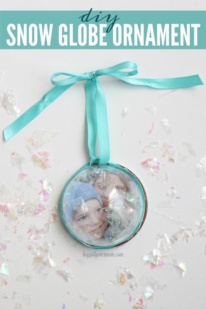 This is TOO cute and so simple to make. I love the idea of making a snow globe ornament with a picture of my kids. I'm kind of obsessed with making ornaments, so this diy snow globe ornament is going to be front and center on my tree!