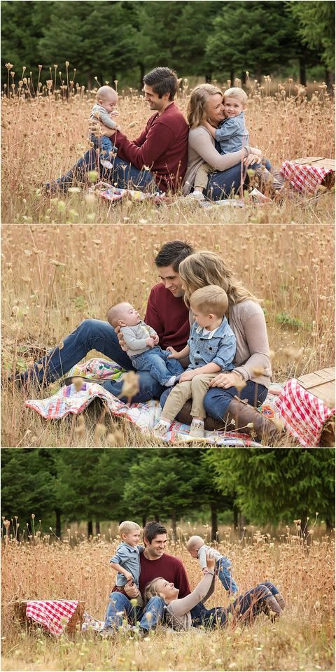 Family of four photographs posing in a field surrounded by trees and grass.  Get rid of the posed family portraits and capture the essence of the family through lifestyle and emotive photography.  Family portraits using a quilt and picnic basket. Salem, Oregon family photographer