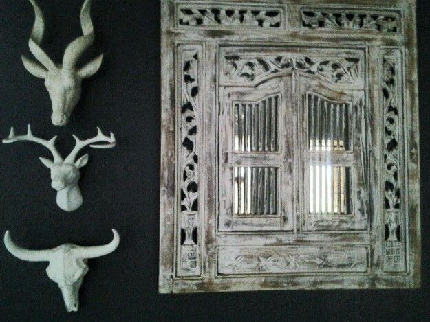 My home entrance wall. White skulls on black with wooden framed mirror
