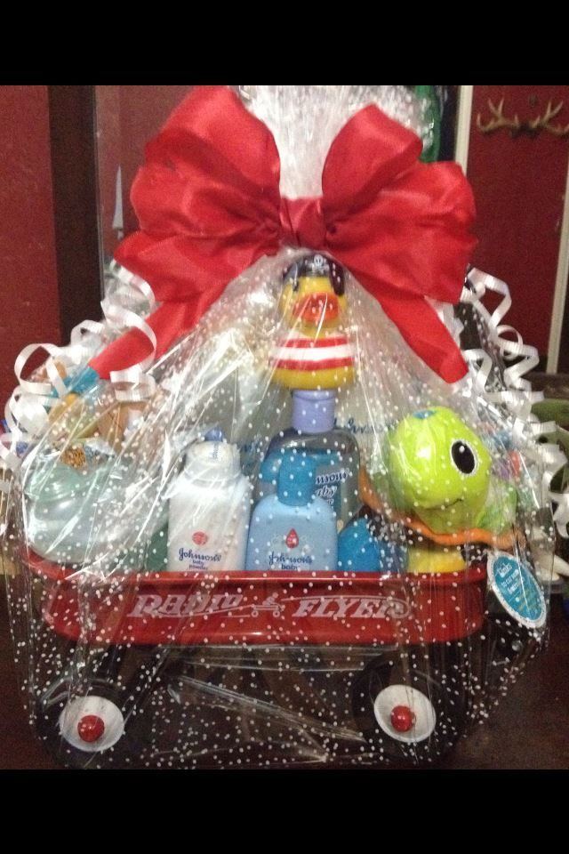 Radio Flyer wagon turned into a gift basket for a baby shower or birthday party. I received a mini Radio Flyer with a baby shower gift, and reuse it every Christmas with my Misfit Toy collection!